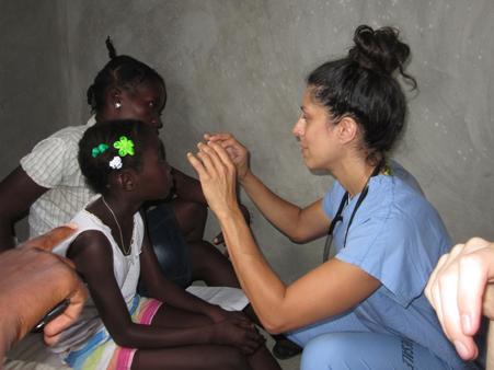 2015 Haiti 20 SE Sante Total clinic Monica D taking pic of patient eye-t
