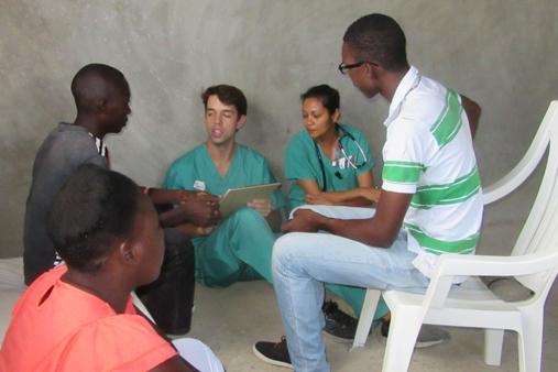 2015 Haiti 21 SE Sante Total clinic Sa B Anjali N & Jos w patients 2-t