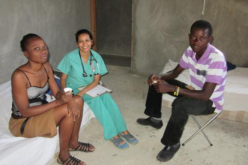 2015 Haiti 22 SE Sante Total clinic Anjali N & Maison w patient-t